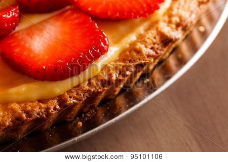 Tasty Strawberry Tart Placed On Wooden Table