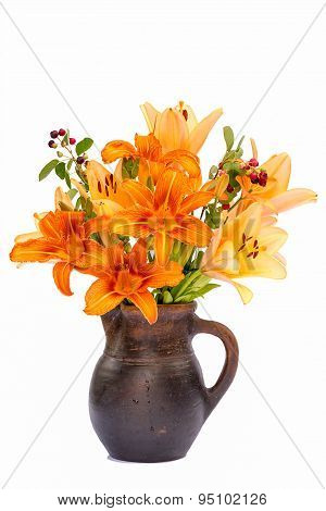 Asiatic Hybrids Orange Lilys Bouquet In A Brown Vase Isolated On White Background