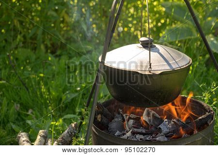 Cooking In The Cauldron On Fire