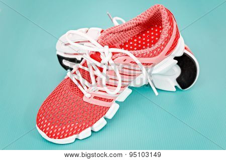 New Orange And White Running Shoe, Sneaker Or Trainer On Blue Background