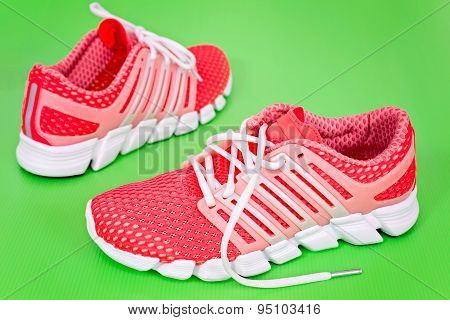 New Orange And White Running Shoe, Sneaker Or Trainer On Green Background