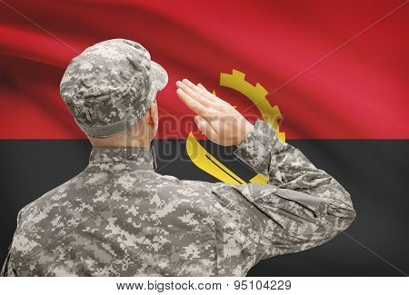 Soldier In Hat Facing National Flag Series - Angola