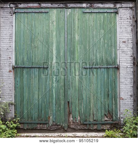 Large Old Barn Doors With Peeling Green Paint