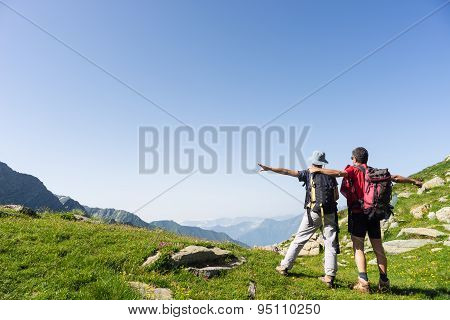 Couple Watching Panorama High Up In The Alps