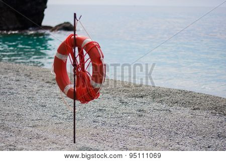 Red Life Buoy On The Beach Of Cinque Terre In Italy.