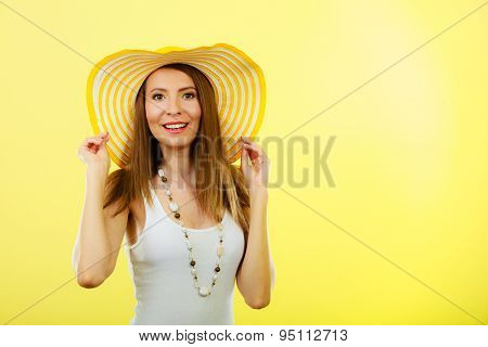 Woman In Big Yellow Summer Hat.