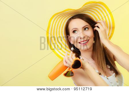 Woman In Summer Hat Holds glasses Sunscreen Lotion