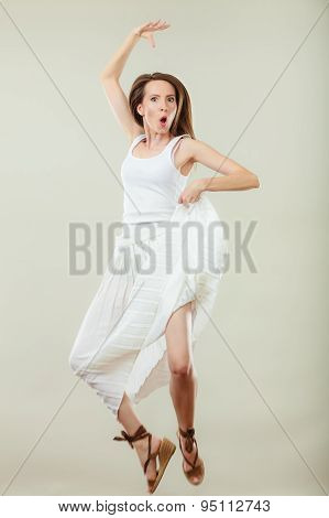 Woman In Summer White Dress Jumping