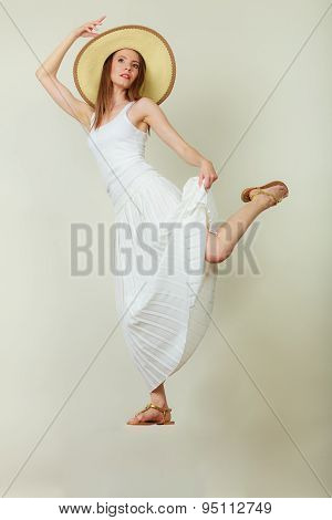 Woman In Straw Summer Hat White Dress Jumping