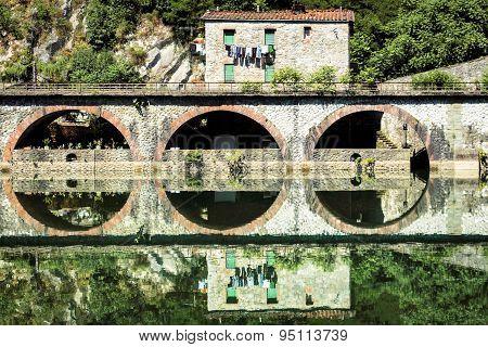 Medieval Ponte Della Maddalena Across The Serchio