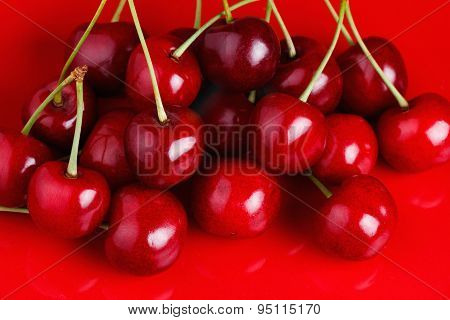 Cherry on a Red Dish