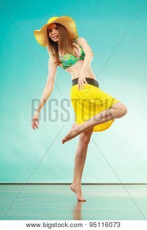 Woman In Straw Summer Hat And Bikini