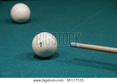 Billiard balls in a pool table in the closeup
