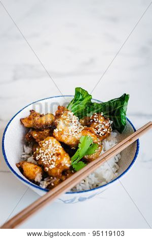 chinese honey chicken with chopsticks