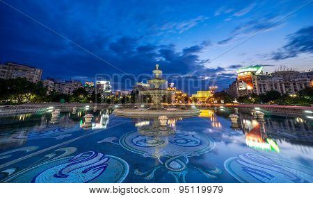 Bucharest Unirii Fountain At Sunset