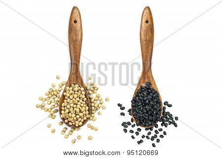 Soy Beans And Black Beans In Wooden Spoon Isolated On White