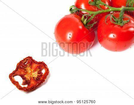 Bunch Of Raw Tomatoes With Water Drops And Dried Slice
