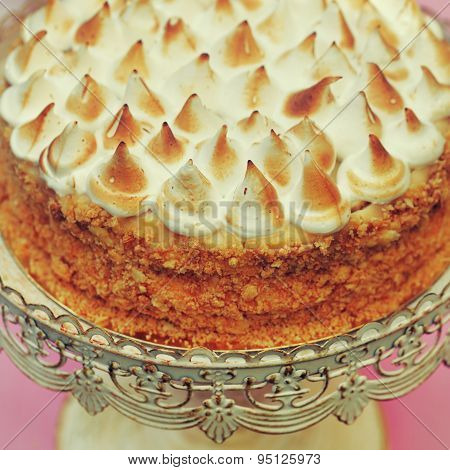 napoleon cake topped with merengue