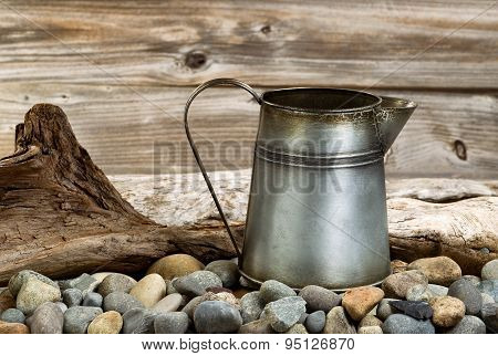 Vintage Coffee Pot On Stone Fire Pit With Driftwood In Background