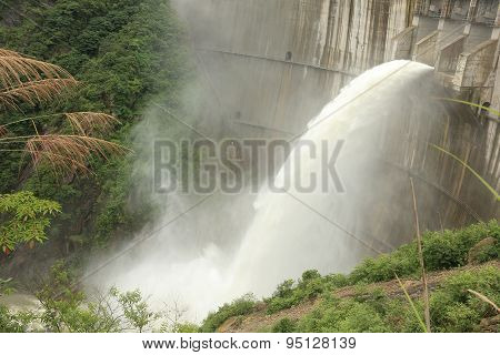 closeup of dam discharge flood water china