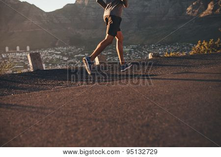 Young Man Running On Country Road