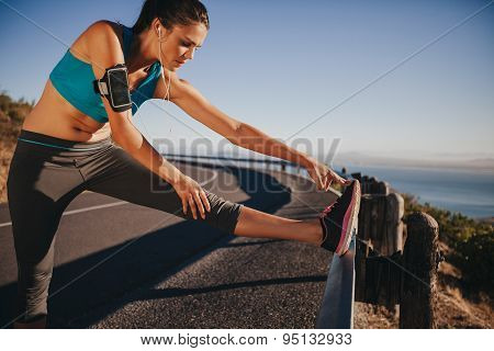 Female Runner Stretching Before Running