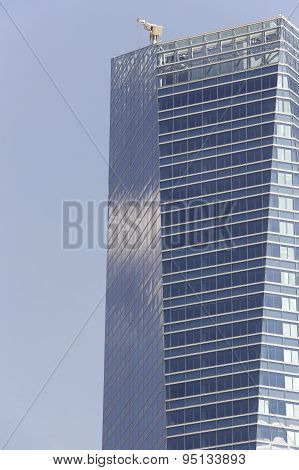 Modern Building Facade And Crane For Cleaning Windows