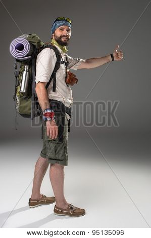 Full length portrait of a male fully equipped tourist