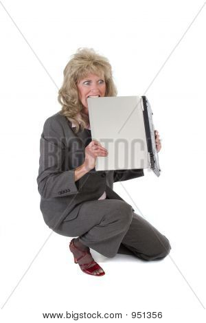 Woman Frustrated With Laptop Biting It