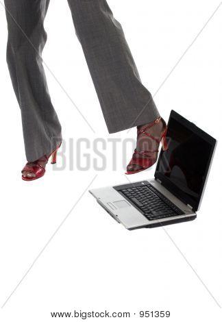 Woman Kicking Laptop