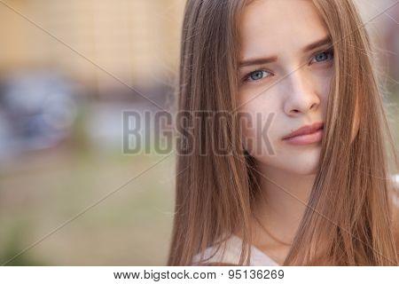 Closeup Portrait Of Beautiful Girl Outdoors