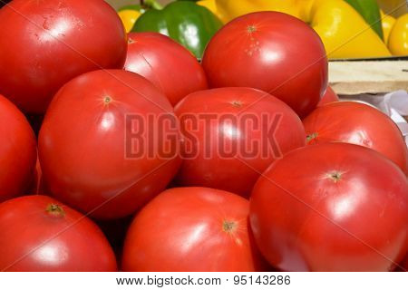red tomatoes in wooden crates