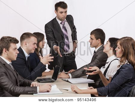 Energetic corporate manager instructs his team