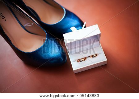 Wedding ring and black shoes