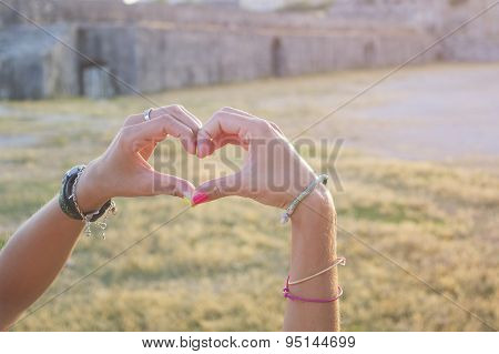 Heart Shape Made Of Girls Hands In An Old Fortres