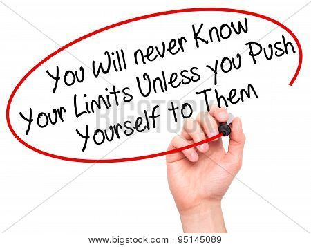 Man Hand writing You Will never Know Your Limits Unless you Push Yourself to Them with black marker