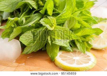 Fresh Mint On The Wood Table With Lemon And Lime