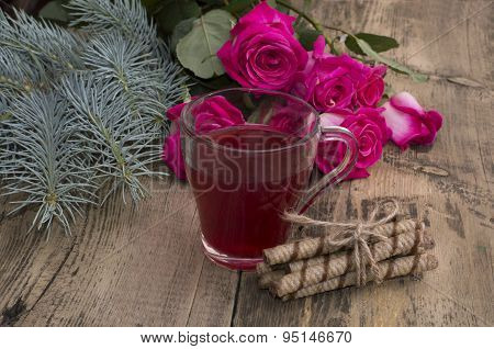 Roses, A Fir-tree Branch And A Mug Of Juice At Center