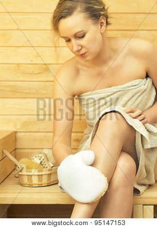 Young Pretty Woman Relaxing In Sauna.