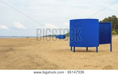 Blue Beach Huts On The Empty Beach.
