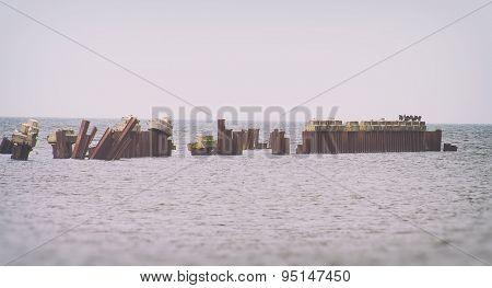 Broken Old Pier With Seagulls In Open Sea.