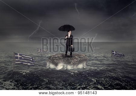 Man Standing On The Rock With Greece Flag Sink On The Sea