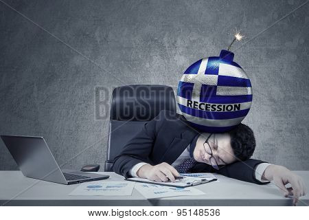 Tired Man Sleeping On Desk With Bomb On Head