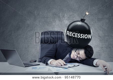 Worker With A Bomb Of Financial Recession