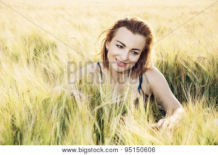 Woman In Love Is Smoothing The Wheat Cobs