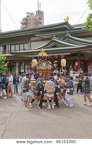 Omikoshi Bearers In Yushima Tenmangu Shrine Of Tokyo, Japan
