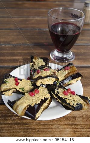 Eggplant phvali and a glass of wine. Georgian cuisine