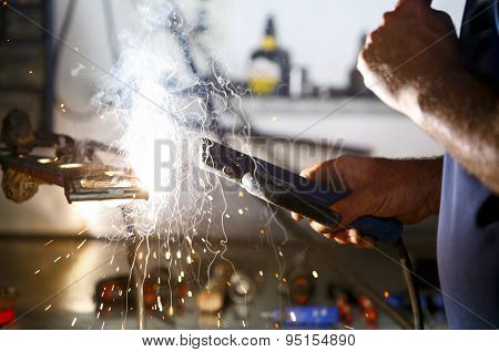 Worker In Action Without Protection Gloves