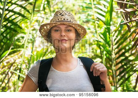 Woman Hiking In Tropical Forest