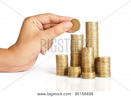 Hand Put Coins To Stack Of Coins